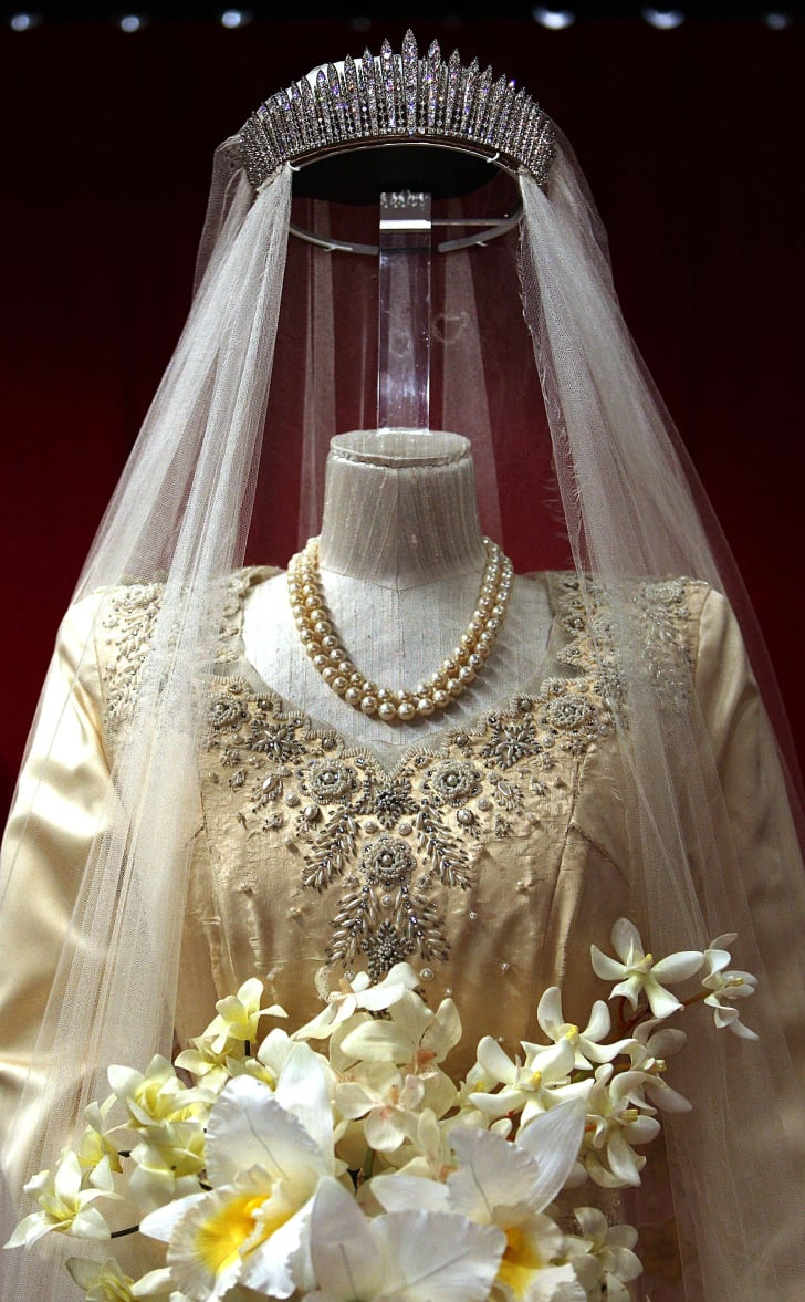 Princess Elizabeth's wedding dress, designed by Norman Hartnell, is displayed at the 'Royal Wedding: 20 Novermber 1957' exhibition at Buckingham Palace on July 27, 2007 in London