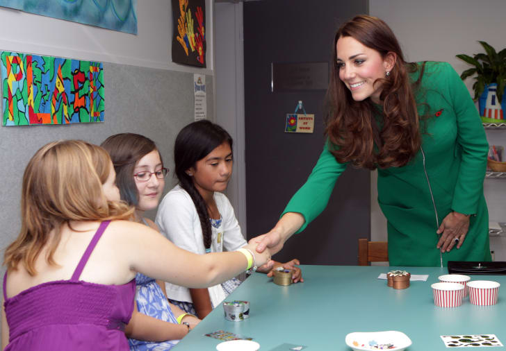Catherine, Duchess of Cambridge keeps her coat on while visiting Waikato Hospice Rainbow Place in Cambridge, New Zealand in 2014.