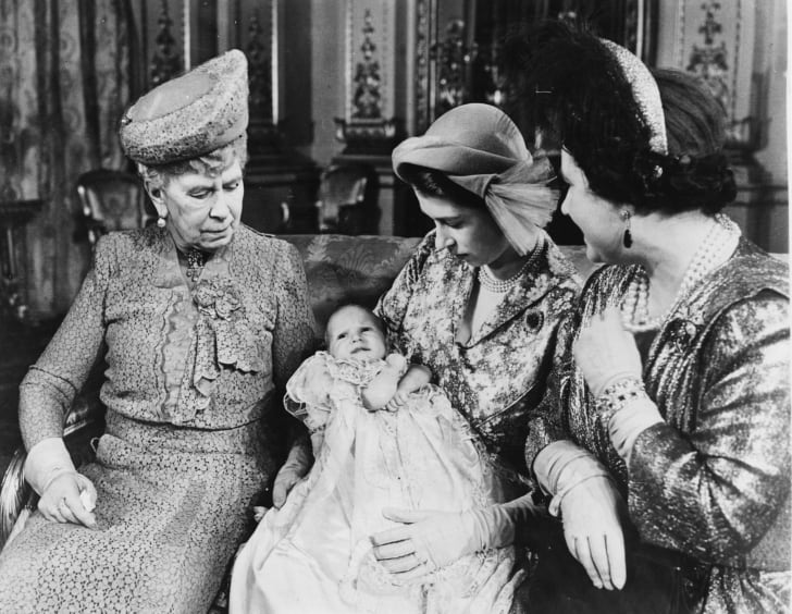 Portrait of then-Princess Elizabeth holding her daughter, Princess Anne, with the grandmothers Queen Mary (left) and Queen Elizabeth, following the christening in October 1950.