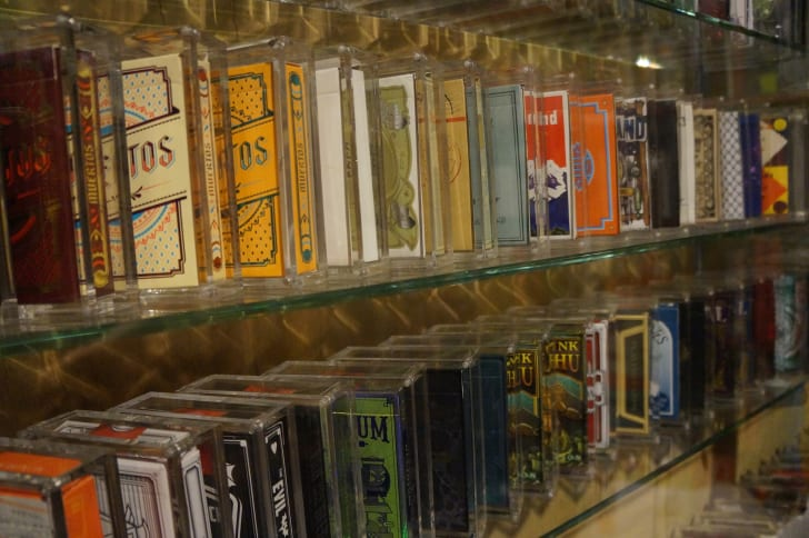 A photo of Expert Playing Cards arranged on a shelf at the Conjuring Arts Library