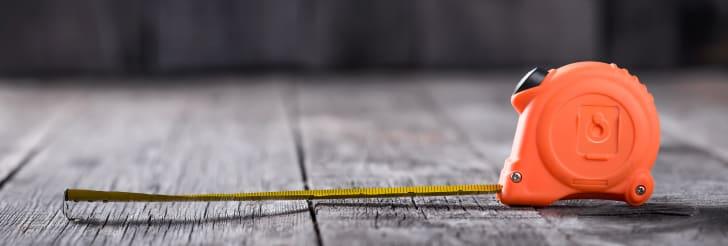 tap measure on a wood floor