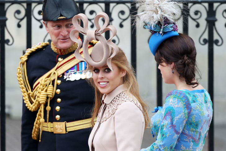 Princess Beatrice of York (L) with her sister Princess Eugenie of York arrive to attend the Royal Wedding of Prince William to Catherine Middleton at Westminster Abbey on April 29, 2011 in London, England