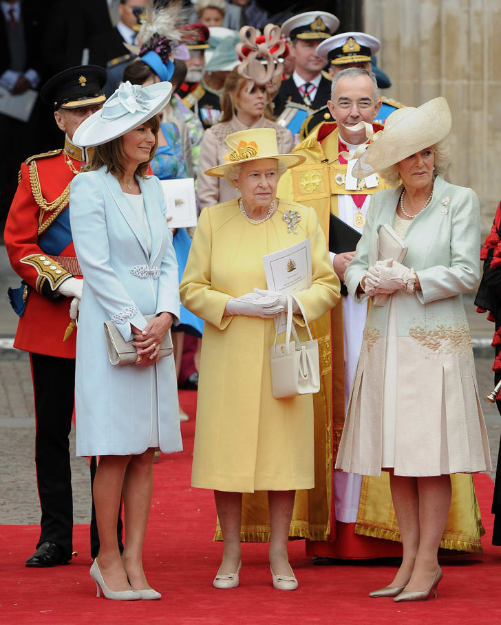 Britain's Queen Elizabeth II (C), Carole Middleton (L) and Camilla, Duchess of Cornwall talk as they come out of Westminster Abbey in London, following the wedding ceremony of Prince William and Kate, Duchess of Cambridge, on April 29, 2011