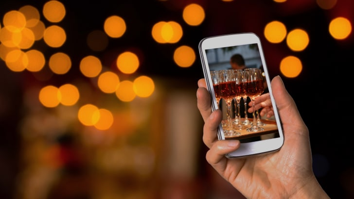 Wedding guest snaps photo of wine glasses during the reception