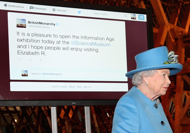 Queen Elizabeth II sends her first Tweet during a visit to the 'Information Age' Exhibition at the Science Museum on October 24, 2014 in London, England
