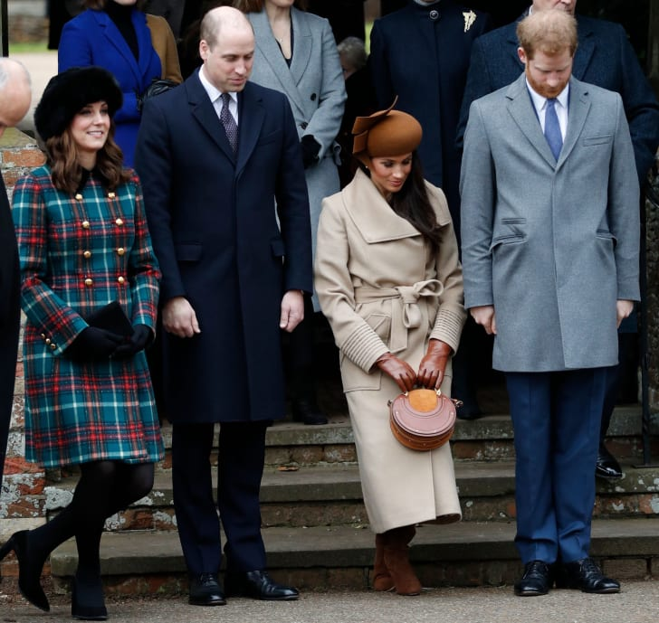 The Duke and Duchess of Cambridge, Meghan Markle, and Prince Harry bow as they see off Britain's Queen Elizabeth II leaving after the Royal Family's traditional Christmas Day church service