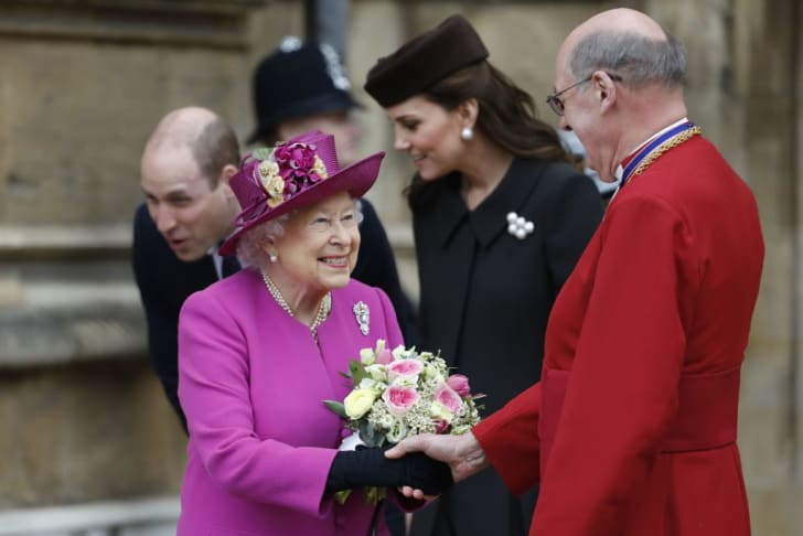 Queen Elizabeth II smiles as she shakes hands with Dean of Windsor, David Conner (R) after attending the Easter Mattins Service at St. George's Chapel, Windsor Castle on April 1, 2018