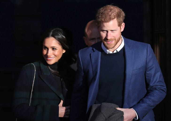 Meghan Markle and Prince Harry leave a reception for young people in the Palace of Holyroodhouse in Edinburgh, during their visit to Scotland on February 13, 2018
