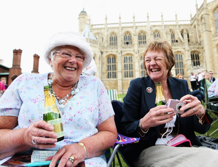 etty Garvey (L) from Manchester and a friend also from Manchester drink champagne as they wait to catch a glimpse of the Royal party in front of St. George's Chapel during Garter Day, the 660th Anniversary Service, on June 16, 2008 in Windsor, England