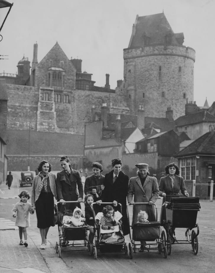 A group of evacuee women and their children with donated prams in Windsor, Berkshire, 5th October 1940. The prams were donated after Queen Elizabeth (later Queen Mother) visited the evacuees and noticed the shortage