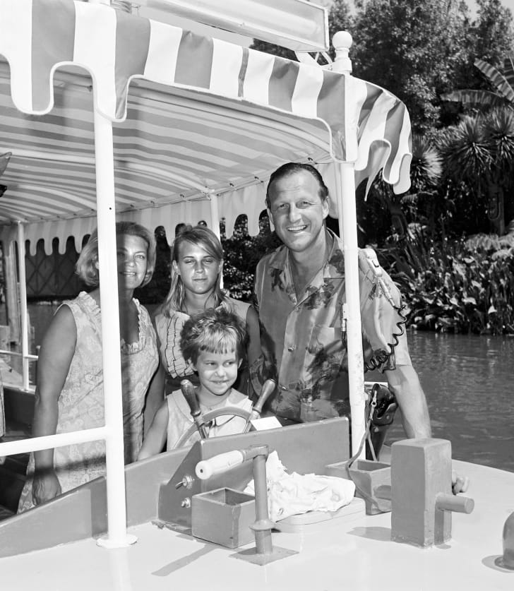 Baseball legend Stan Musial and his family are seen on the Jungle Cruise attraction at Disneyland Park in July, 1965 in Anaheim, California