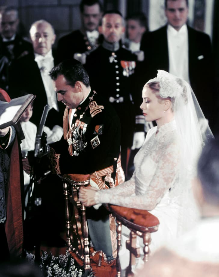 U.S. actress Grace Kelly and Prince Rainier of Monaco during their wedding ceremony in Monaco.