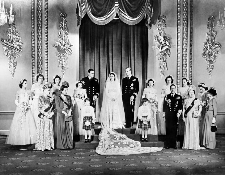 Members of the British Royal family and guests pose around Princess Elizabeth (future Queen Elizabeth II) and Philip, Duke of Edinburgh.