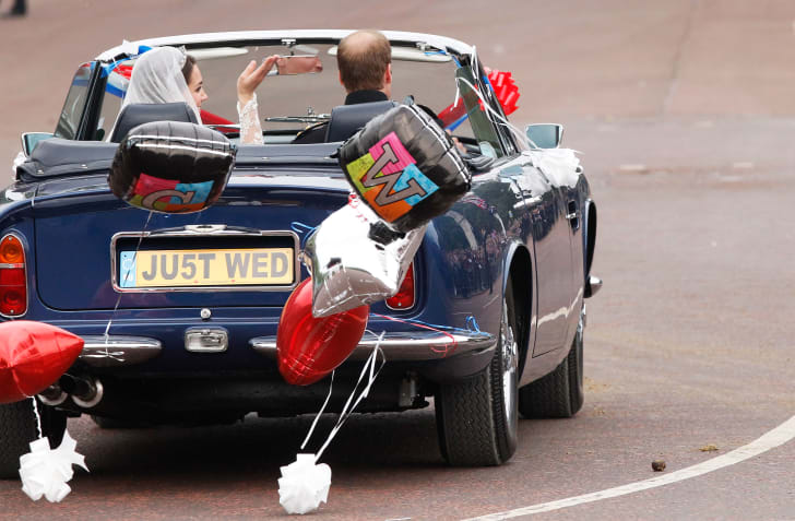 Prince William and Kate Middleton drive away from Buckingham Palace on their wedding day.