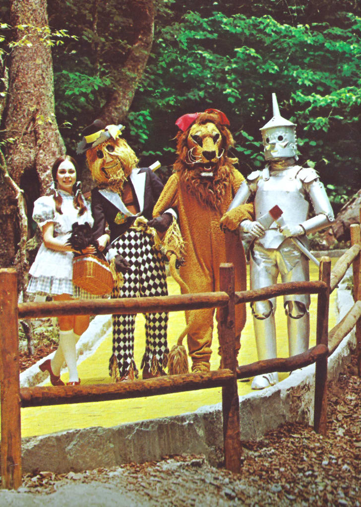 Dorothy and characters in costume at Land of Oz in 1970