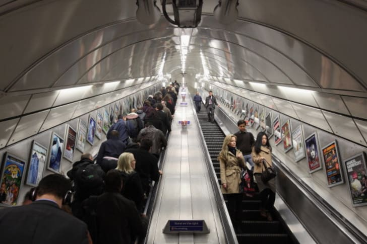 Commuters on the escalator at London's Angel underground station, which are the longest escalators on the tube network.