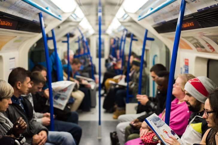 Passengers ride the London Tube