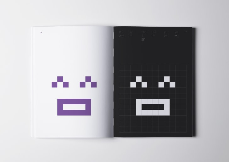 Book with smiling emoji in color and black-and-white.