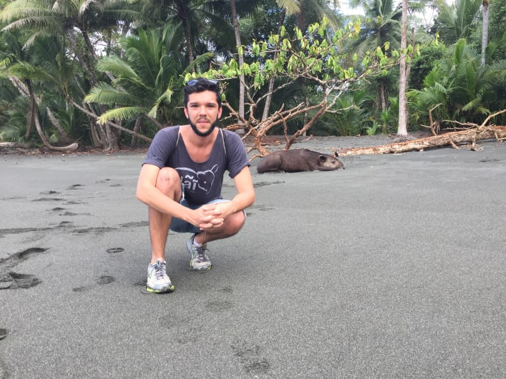 Nai Conservation researcher and activist Mauricio Sanabria with a tapir on the beach in Costa Rica's Corcorvado National Park.