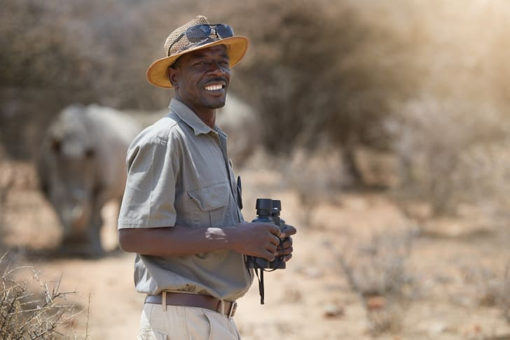 man with binoculars in the wild