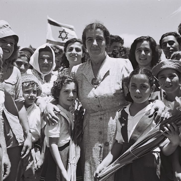 Meir with Israeli children in 1950