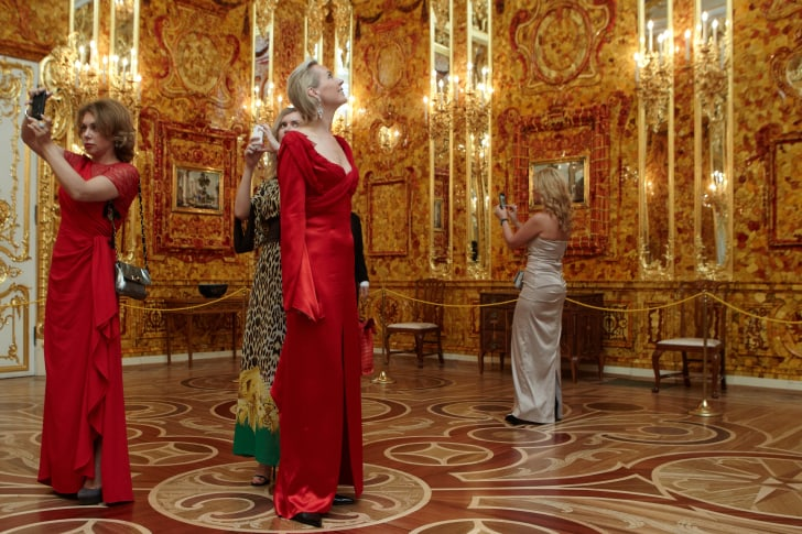 Guests at a reconstructed version of the Amber Room