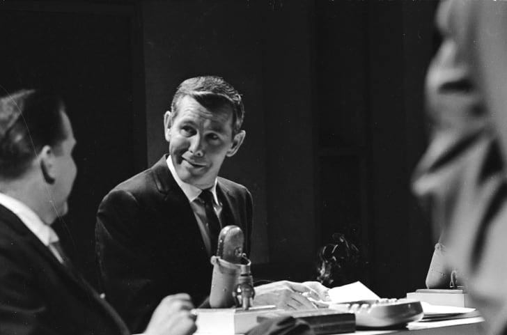 Johnny Carson at a microphone