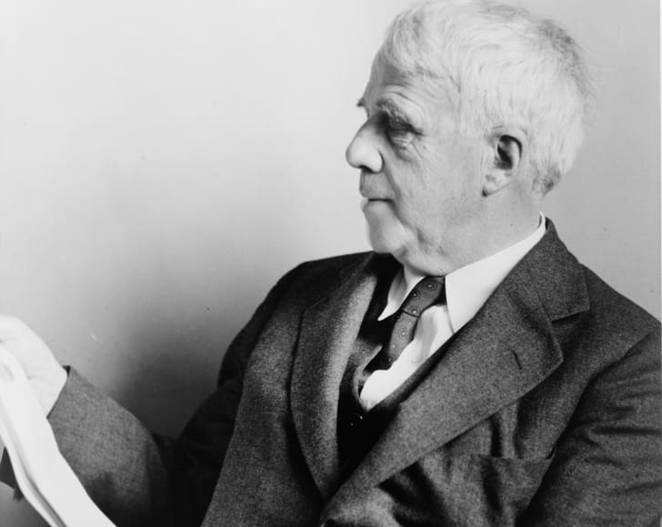 Poet Robert Frost posing for a photo