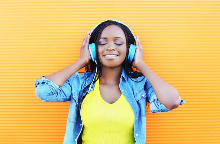 woman enjoys listening to music in headphones