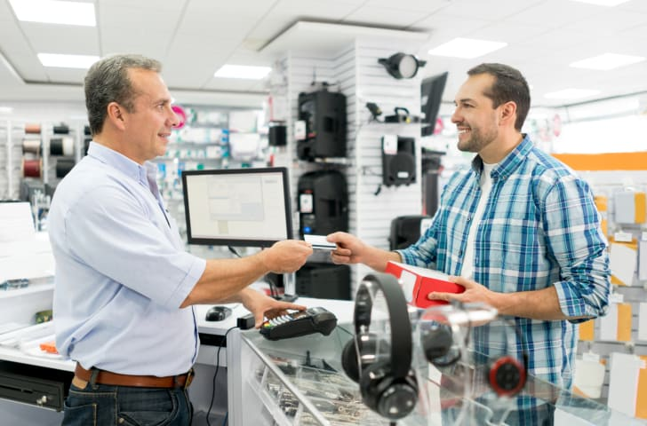 man returns electronics at a store