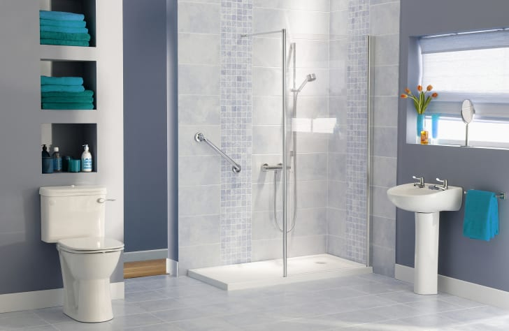 tiled bathroom with shower stall