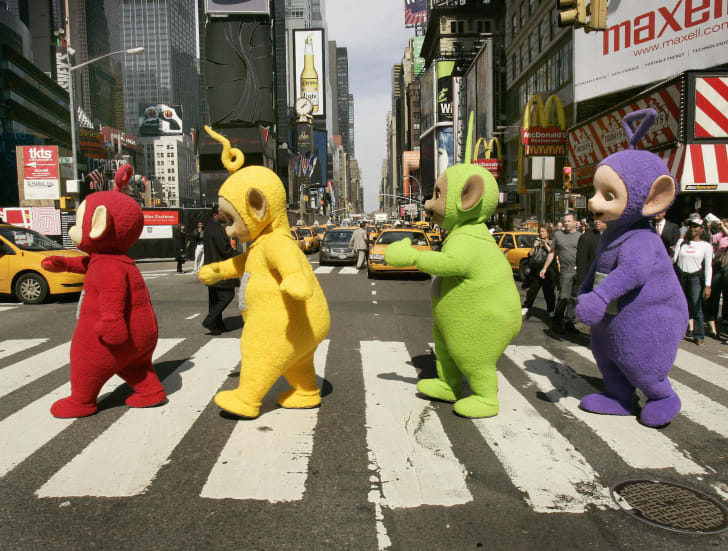 The world famous Teletubbies (L-R) Po, Laa-Laa, Dipsy and Tinky-Winky cross 7th Avenue in Times Square in New York 27 March 2007 as they arrive on American soil in person for the first time ever.