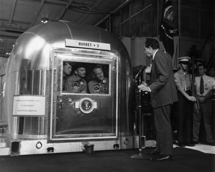 Richard Nixon greets the returning Apollo 11 astronauts