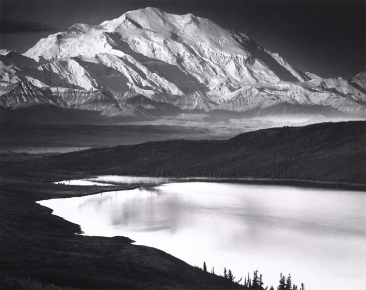 A black-and-white photo of Denali as seen from across Wonder Lake