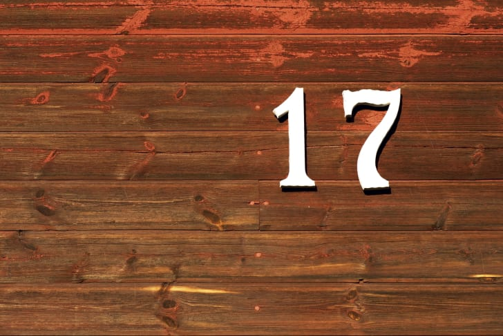 number 17 on a wooden background