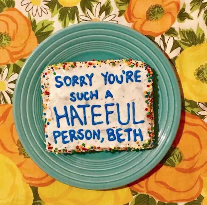 cake with a troll comment on it
