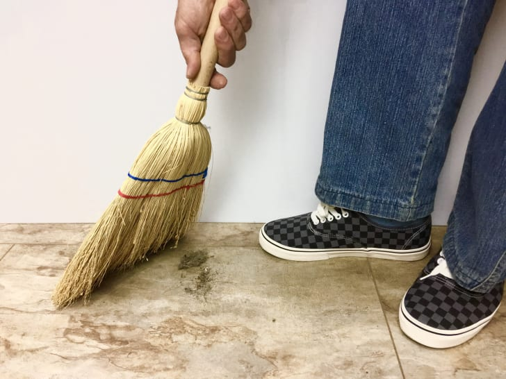 Person sweeping the floor