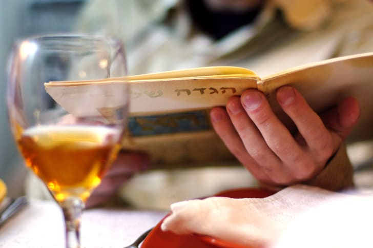 reading the Haggadah at Passover
