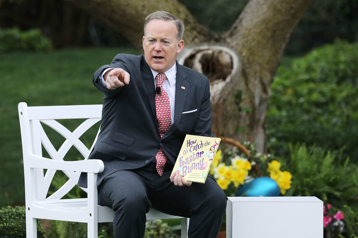 Then-White House Press Secretary Sean Spicer reads a book to children during the White House's annual Easter Egg Roll in 2017.