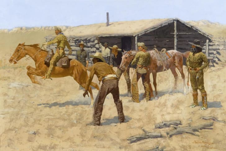 A painting of a Pony Express rider taking off on a new horse from a station
