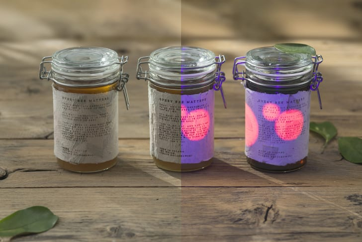And image of honey jars with Bee Saving Paper labels divided in half to see the visible light vs. UV-ray views.