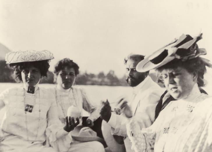 Emilie, Helene und Pauline Floege sitting in a rowboat with Gustav Klimt.
