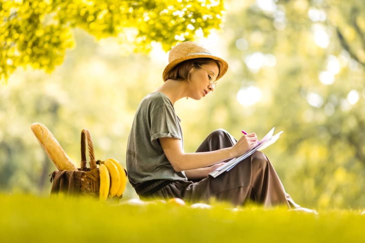woman writing in a park