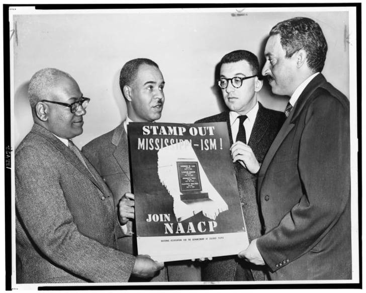 Thurgood Marshall holds NAACP sign with other civil rights leaders