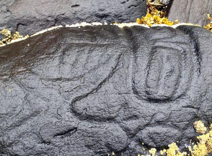 Carving depicting a sasquatch near Klemtu, British Columbia