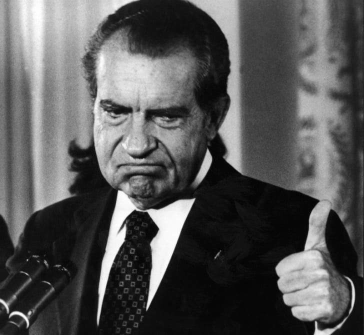 Richard Nixon frowns during a public appearance