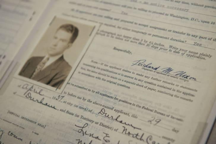 A photograph of Richard Nixon's 1937 FBI application
