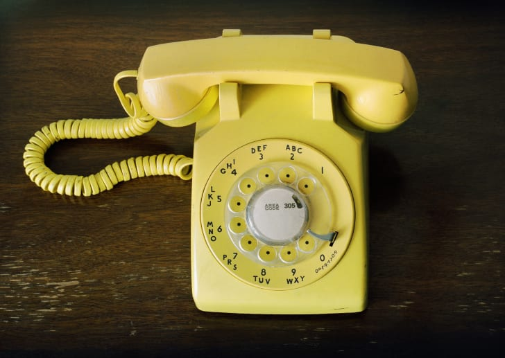 Yellow rotary phone.