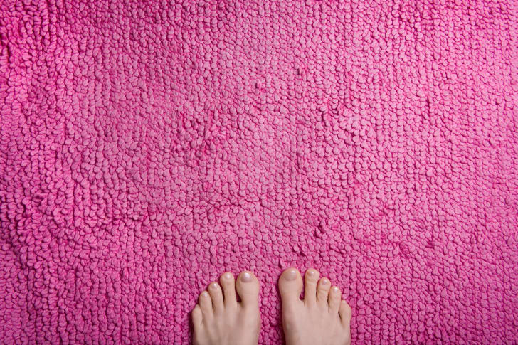 Feet on a pink rug