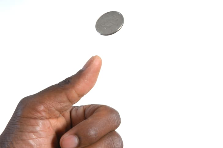 Thumb flipping a coin.